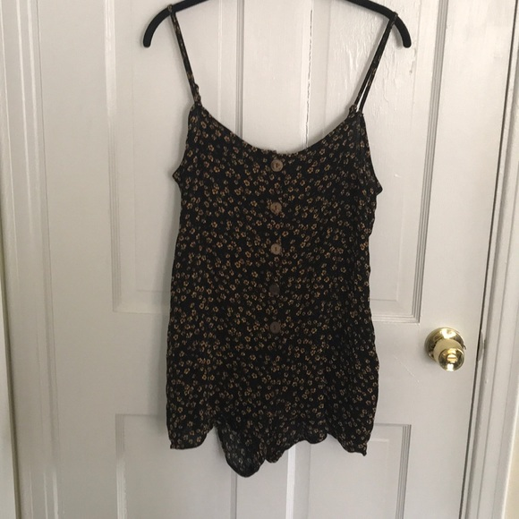 Large floral romper black and yellow